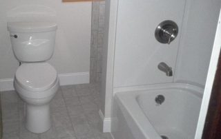 white bathroom with tiled floor