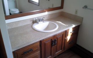 bathroom with wood vanity